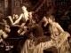 Massenet faisant travailler le rôle de Manon à Sybil Sanderson (1887) derrière sa mère et sa sœur. Peinture d' Aublet